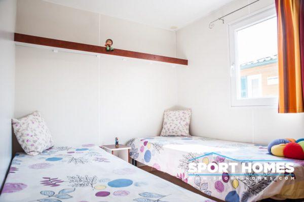 casa prefabricada Trigano Sympa vista habitación de dos camas